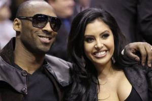This Feb. 13, 2010 file photo shows Los Angeles Lakers' Kobe Bryant and his wife, Vanessa, attending the skills competition at the NBA basketball All-Star Saturday Night in Dallas.