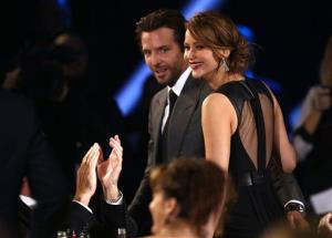 Bradley Cooper, left, and Jennifer Lawrence are seen at the 18th Annual Critics' Choice Movie Awards at the Barker Hangar on Thursday, Jan. 10, 2013, in Santa Monica, Calif.