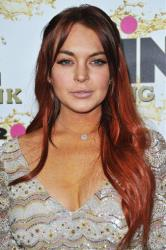 In this Oct. 11, 2012 file photo, Lindsay Lohan attends the Mr. Pink Ginseng launch party at the Beverly Wilshire hotel in Beverly Hills, Calif.