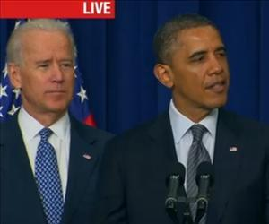 Barack Obama delivers his gun control proposals with Joe Biden by his side in this screenshot from CNN's live feed.