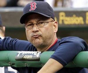 In this June 25, 2011, file photo, Boston Red Sox manager Terry Francona stands in the dugout during a 6-4 loss to the Pittsburgh Pirates