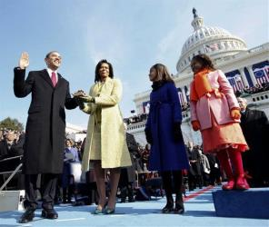 In this Jan. 20, 2009, photo, Barack Obama takes the oath of office from Chief Justice John Roberts, not seen, as Michelle holds the Lincoln Bible and daughters Sasha, right, and Malia, watch.