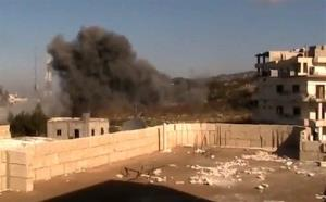 In this image taken from video obtained from the Shaam News Network, which has been authenticated based on its contents and other AP reporting, smoke rises from buildings due to heavy shelling in Latakia, Syria, on Monday, Jan. 14, 2012.