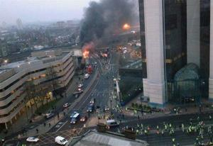 This overhead view shows smoke and flames at the site of a helicopter crash in central London, as people gather to view the scene shortly after the incident, early Wednesday Jan. 16, 2013.