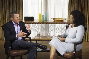 Lance Armstrong talks with Oprah Winfrey.