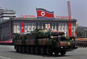 In this April 15, 2012 file photo, a North Korean vehicle carries a missile.