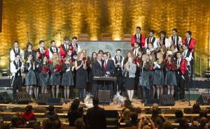 Ban Ki-moon and Vuk Jeremic are surrounded by the Belgrade vocal group, Viva Vox, in the General Assembly Hall at UN headquarters in New York.