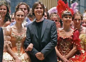 In this Sept. 20, 2011 photo, Sergei Filin, center, poses with members of the Bolshoi Theater company involved in the Sleeping Beauty ballet, after a rehearsal, in the Bolshoi Theater, Moscow, Russia.