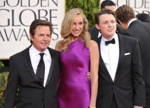 Actors Michael J. Fox, Tracy Pollan, and Sam Fox arrive at the 70th Annual Golden Globe Awards at the Beverly Hilton Hotel on Sunday Jan. 13, 2013, in Beverly Hills, Calif.