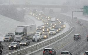Snow brings traffic to a crawl on Interstate 40 last night in Knoxville, Tenn.  A winter storm was making its way across the Southeast.