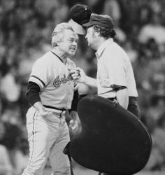 In this 1974 file photo, Baltimore Orioles manager Earl Weaver protests a call by home plate umpire Marty Springstead.