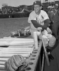 In this May 13, 1958 file photo, Stan Musial, St. Louis Cardinal all-time great baseball player, poses in dugout prior a baseball game against the Chicago Cubs in Chicago.