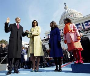 In this Jan. 20, 2009, file photo, Barack Obama takes the oath of office from Chief Justice John Roberts as his wife Michelle, holds the Lincoln Bible and daughters Sasha and Malia watch.