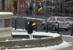 A man sets himself ablaze in Wenceslas Square in the centre of Prague, Czech Republic, Sunday afternoon, Jan. 20, 2013.
