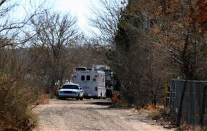 Bernalillo County authorities are stationed outside a home south of Albuquerque, New Mexico where two adults and three children were found shot to death.