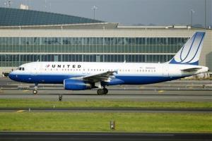 In this Saturday, Aug. 11, 2012 file photograph, a United Airlines passenger plane taxis  at Newark Liberty International airport in Newark, NJ.