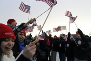 Spectators wave American flags on the National Mall in Washington, Monday, Jan. 21, 2013.