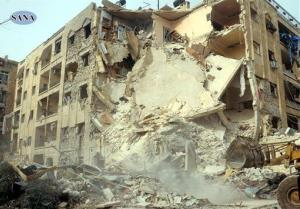 This photo released by the Syrian official news agency SANA, shows damage after a rocket slammed into a building, killing at least 12 people, in Aleppo, Syria, Friday, Jan. 18, 2013.