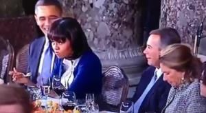 Michelle Obama reacts to John Boehner at the inaugural luncheon today in Washington, DC.