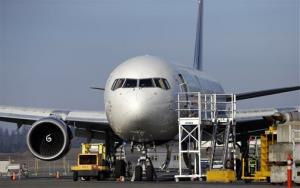 A 787 jet painted in a Delta livery is seen Thursday, Jan. 17, 2013, at Paine Field in Everett, Wash.