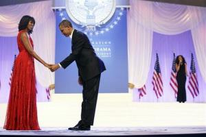 President bama bows as he and first lady Michelle Obama, wearing a ruby colored chiffon and velvet Jason Wu gown, gets ready to dance.