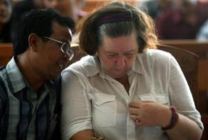 Lindsay June Sandiford of Britain, right, listens to her interpreter during her sentencing at a courthouse in Bali today.
