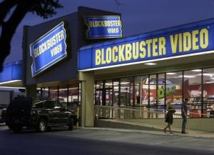 This July 23, 2006 file photo shows customers enter a Blockbuster video store in Dallas.