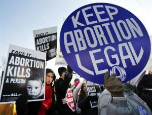 Anti-abortion and abortion activists stand side by side in front of the US Supreme Court, in Washington, Jan. 24, 2011, during a rally against Roe v. Wade on the anniversary of the court decision.