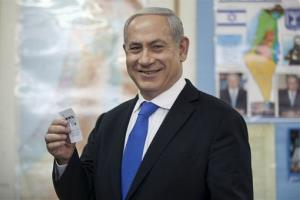 Israeli Prime Minister Benjamin Netanyahu casts his ballot?at a polling station in Jerusalem, Tuesday, Jan. 22, 2013.