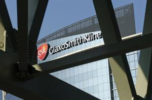 A sign for British pharmaceuticals firm GlaxoSmithKline is seen on its offices in London.