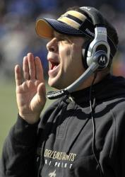 In this 2011 file photo, New Orleans Saints head coach Sean Payton yells from the sideline.