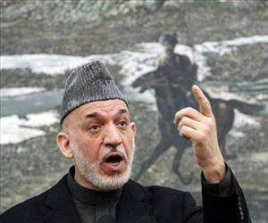 Afghan President Hamid Karzai speaks during a press conference at the presidential palace in Kabul, Afghanistan, Jan. 14, 2013.