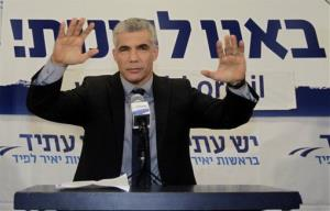 Yesh Atid party leader Yair Lapid gestures as he delivers a speech at party headquarters in Tel Aviv this morning.