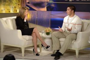 This Jan. 22, 2013 photo released by ABC Notre Dame linebacker Manti Te'o, right, speaking with host Katie Couric during an interview for Katie, in New York.