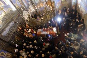 Patriarch Irinej performs the liturgy during a solemn ceremony after the remains of Yugoslavia's last king — Peter II Karadjordjevic were flown back to Serbia in Belgrade, Serbia, Tuesday, Jan. 22.