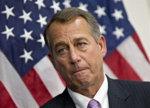 Speaker of the House John Boehner, R-Ohio, talks to reporters after a long closed-door meeting on a strategy to deal with a potential debt crisis, at the Capitol in Washington, Tuesday, Jan. 22, 2013.
