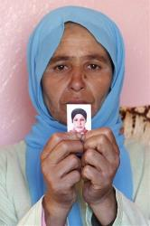 In March 16, 2012, photo, Zohra Filali, the mother of rape victim Amina Filali, shows a picture of her daughter.