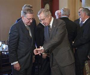 Harry Reid and Mitch McConnell confer on Capitol Hill, March 6, 2012.