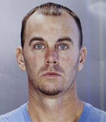 This undated photo provided by the Philadelphia Police Department shows Jason Smith.