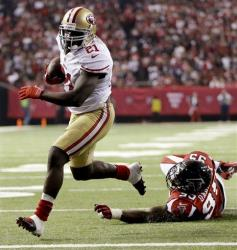 FILE - In this Jan. 20, 2013, file photo, San Francisco 49ers running back Frank Gore (21) gets away from Atlanta Falcons defensive end Jonathan Babineaux (95) for a 5-yard touchdown run during the second half of their NFL football NFC championship game in Atlanta. Gore was fined $10,500...