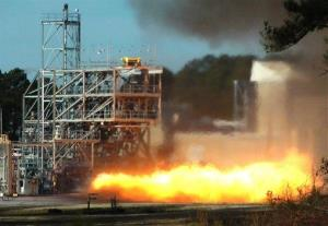 In this image taken from video, NASA engineers test fire a key part of a rocket engine left over from the 1960s-era Apollo moon missions on Thursday.