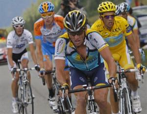 Lance Armstrong, center, sets the pace for his teammate and overall leader Alberto Contador of Spain, right; second left is Bradley Wiggins of Britain.