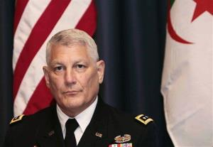 In this Sept. 8, 2011 photo, Gen. Carter Ham, head of the US African command, attends a conference on terrorism in the Sahara in Algiers, Algeria.