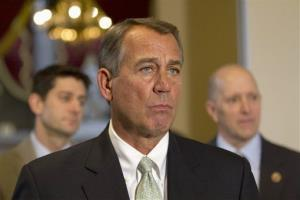 House Speaker John Boehner, flanked by Paul Ryan and Dave Camp, addresses reporters on Jan. 23.