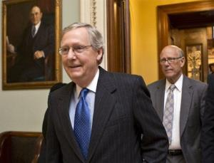 This Dec. 30, 2012 file photo shows Senate Minority Leader Mitch McConnell of Ky., followed by Sen. Pat Roberts, R-Kansas, leaving the Senate chamber on Capitol Hill in Washington.