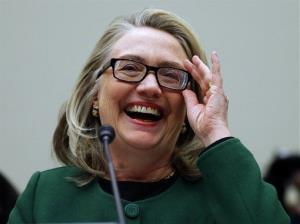 Secretary of State Hillary Rodham Clinton smiles during a lighter moment as she testifies on Capitol Hill, Wednesday, Jan. 23, 2013, before the House Committee on Foreign Affairs about the deadly September attack on the U.S. diplomatic mission in Benghazi, Libya, that killed Ambassador Chris Stevens and three other...