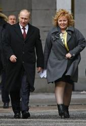 Russian Prime Minister and presidential candidate Vladimir Putin, left, and his wife Lyudmila arrive at a polling station in Moscow, Russia, Sunday, March 4, 2012.