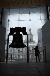 A tourist visits the Liberty Bell during a winter storm, Saturday, Dec. 19, 2009, in Philadelphia.