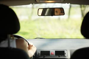Stock photo of a woman driving her car.