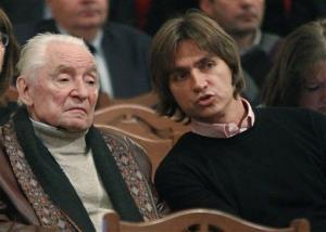 The Bolshoi Theater artistic director Sergei Filin, right, speaks to the Bolshoi Theater choreographer Yuri Grigorovich, left, in September of 2011.